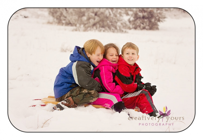 Family Pictures on a Flexible Flyer sled in Spokane WA
