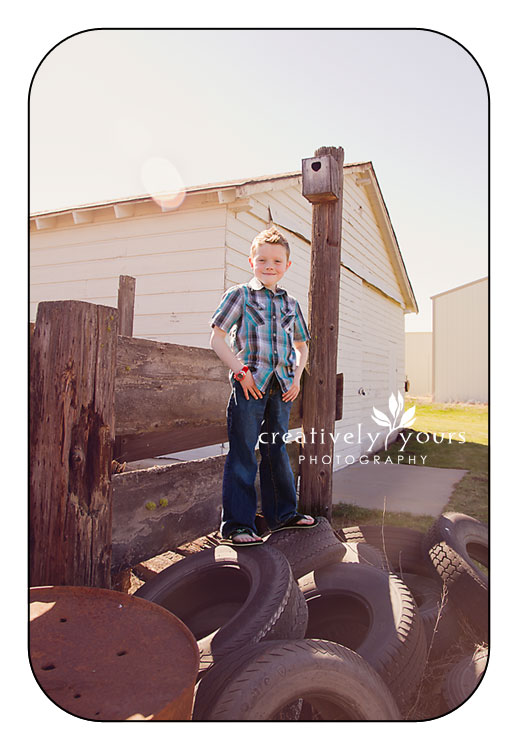 Little boy pictures in a junkyard by Creatively Yours
