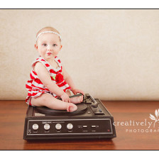 Baby with a vintage record player in Spokane WA