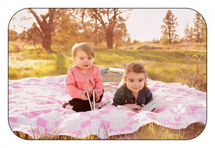 Sweet Sisters reading books in a field by Creatively Yours