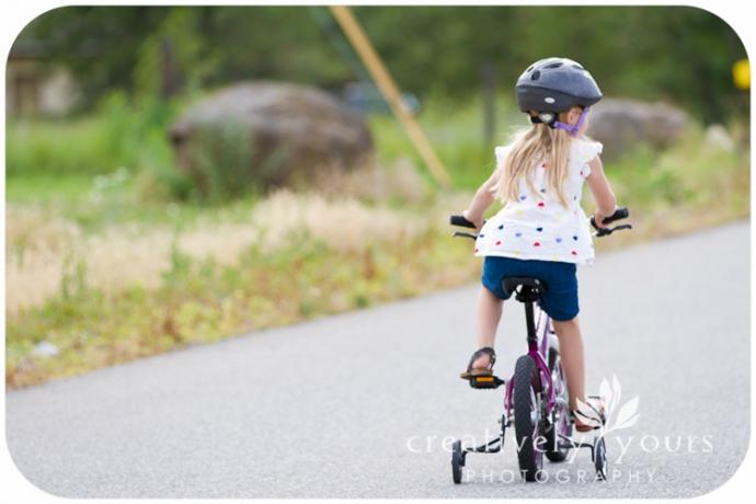 Cute little girl on her bike in Spokane WA