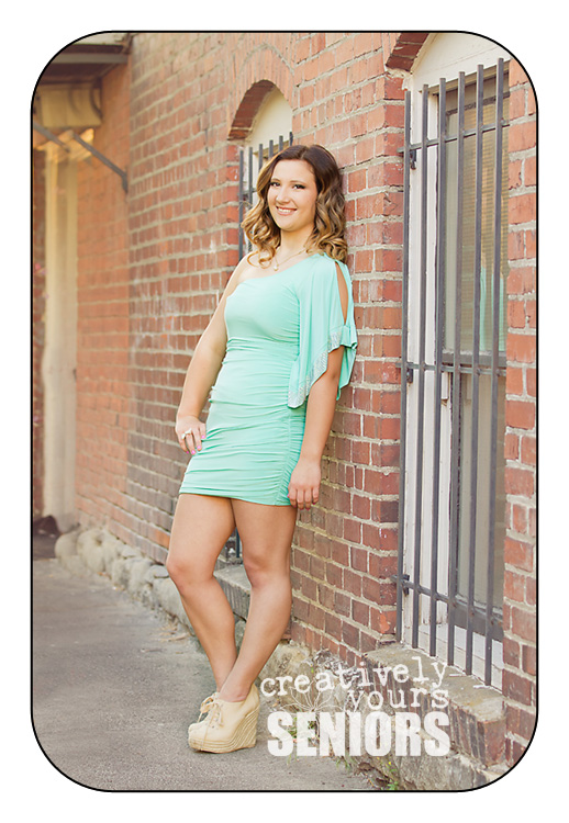 Senior Girl in a gorgeous mint colored dress in Downtown Spokane