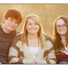 Gorgeous photo of siblings in the field in the fall in Spokane WA