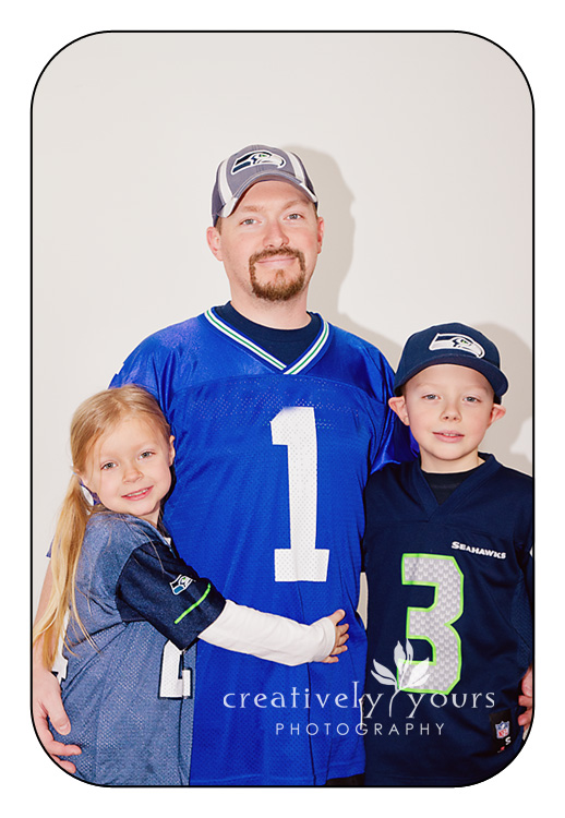 Family picture in Seahawk jerseys by Spokane Photographer, Creatively Yours