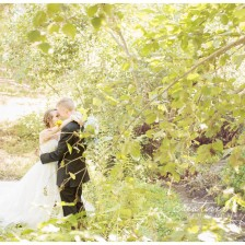 Fall Bride and Groom portraits by Creatively Yours Photography in a forest in northern Spokane.