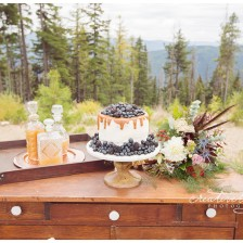 Fall wedding by Silver Mountain Wedding Photographer, Creatively Yours Photography. Cake table for mountain top wedding in Northern Idaho